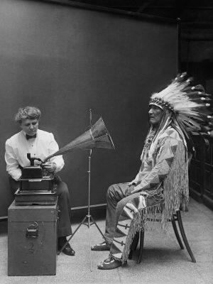 800px-Frances_Densmore_recording_Mountain_Chief2